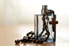 Cologne bottle and rosary. A view with a bottle of perfume and rosary stock photos
