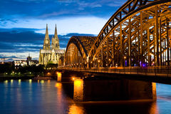 Cologne Cathedral. And the river Rhine after sunset, Germany Stock Photo