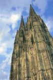 Cologne Cathedral. Looking up at cologne cathedral germany with a bright blue sky background Royalty Free Stock Photo