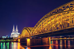 Cologne Cathedral and bridge night scene Stock Images