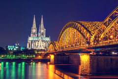 Cologne Cathedral and bridge night scene Royalty Free Stock Photos