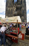Cologne Cathedral. A coffee vendor in front of Cologne Cathedral. Cologne Cathedral (High Cathedral of St. Peter) is a Roman Catholic Church in Cologne, Germany royalty free stock photos