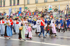 Munich, Germany, September 18, 2016: The Traditional Costume Parade during Octoberfest 2016 in Munich. German people wearing traditional costumes marching Stock Images