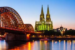 The Cologne Cathedral in Germany. Cologne Cathedral and Hohenzollern Bridge through Rhine river in Cologne, Germany royalty free stock photography