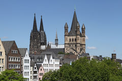 Cologne Cathedral and Gross St. Martin. World Famous Cologne Cathedral (left) and Gross St Martin (Great Saint Martin), one of Cologne's twelve famous Romanesque Royalty Free Stock Photo