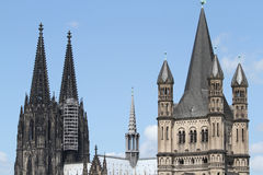 Cologne Cathedral and Gross St. Martin. World Famous Cologne Cathedral (left) and Gross St Martin (Great Saint Martin; right), one of Cologne's twelve famous Royalty Free Stock Photos