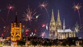 Cologne cathedral under fireworks. The Cologne Cathedral and the Historisches Rathaus under fireworks at night in Cologne, Germany Stock Images