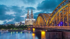 Cologne Cathedral and Hohenzollern Bridge in evening. Cologne, Germany Static image with animated sky and water stock video