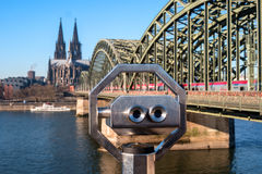 Cologne Cathedral and Hohenzollern Bridge. In the foreground of public Binocular Telescope. Royalty Free Stock Photography