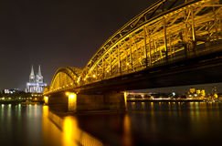 Cologne Cathedral and Hohenzollern Bridge, Germany. Cologne Cathedral and Hohenzollern Bridge at night, Cologne, Germany Royalty Free Stock Image