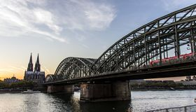Cologne Cathedral and Hohenzollern Bridge at night royalty free stock photo