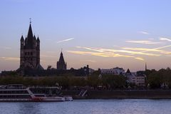 Cologne Cathedral and Hohenzollern Bridge at night stock images