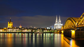 Cologne Cathedral with the Hohenzollern bridge at night Stock Image