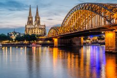 Cologne Cathedral and Hohenzollern Bridge at night, Germany Royalty Free Stock Photography