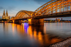 Cologne Cathedral and Hohenzollern Bridge at night, Germany Royalty Free Stock Image