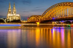 Cologne Cathedral and Hohenzollern Bridge at night, Germany Stock Photography