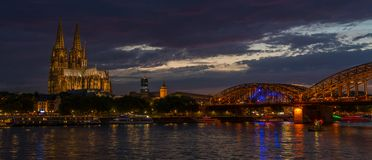 Cologne Cathedral and the Hohenzollern Bridge at night on the River Rhine, Germany royalty free stock image