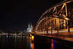 Cologne Cathedral and Hohenzollern Bridge. Night shot of Cologne Cathedral with the Hohenzollern Bridge Stock Image