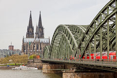 Cologne Cathedral and Hohenzollern Bridge over Rhine river Royalty Free Stock Photos