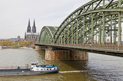 Cologne Cathedral and Hohenzollern Bridge over Rhine river Stock Photography