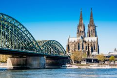 Cologne cathedral and Hohenzollern Bridge. The Cologne cathedral and the Hohenzollern Bridge over river Rhine in the city of Cologne, Germany Royalty Free Stock Photo
