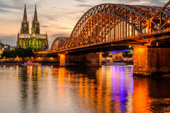 Cologne Cathedral and Hohenzollern Bridge at sunset, Germany Royalty Free Stock Photography