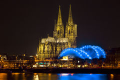Cologne Cathedral (Kolner Dom) on Christmas eve at dusk. Cologne Cathedral (German: Kolner Dom, officially Hohe Domkirche St. Peter und Maria) across the Rhine Stock Image