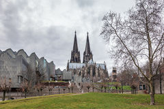 Cologne Cathedral and Modern philharmonic concert hall Stock Photo