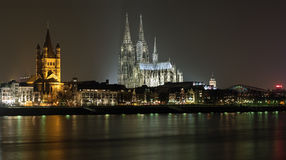Cologne Cathedral and St. Martin Church in night Stock Image