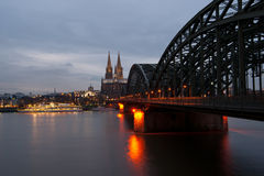 Cologne Cathedral during sundown in december 2011. And a illuminated christmas ship on the rhine Royalty Free Stock Photography