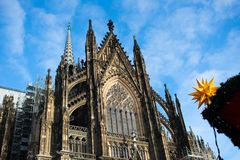 Cologne cathedral on sunny blue background stock photography