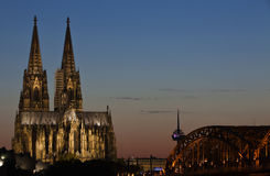 Cologne cathedral at Sunset. Cologne Cathedral, the TV tower and the railway bridge in Cologne,Germany taken at sunset Royalty Free Stock Photos