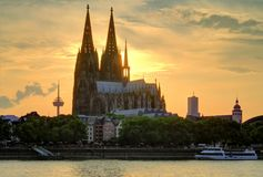 Evening in Koeln, Koelner Dome. Cologne Cathedral at Sunset, Rhine river in the foreground Stock Photo