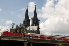 Cologne cathedral and train DB. Arrival by train to Cologne - cathedral towers Royalty Free Stock Image