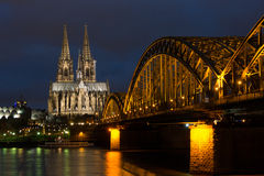 Cologne Catheral and Skyline at Night. Skyline of Cologne, Germany with the illuminated cathedral, Hohenzollern Bridge and the River Rhein at night Stock Photos