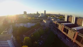 Cologne city skyline aerial shot, sunset pan above view building stock footage