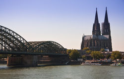 Cologne, Dom and Bridge View. A clear shot of the Dom and the bridge taking trains to the main station in Cologne from the main river, Germany Royalty Free Stock Image