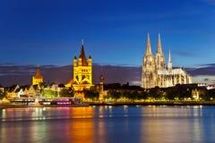 Cologne domkyrka och stor St. Martin Church Royaltyfri Foto