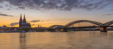 Cologne evening on the Rhine river after sunset. View to the Cologne Cathedral and the Hohenzollernbridge shortly after sunset Stock Image