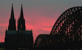 Cologne on fire. The landmarks of Cologne (Germany) at sunset Royalty Free Stock Photo