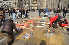Painting on a pavement on front of the cathedral Royalty Free Stock Photos