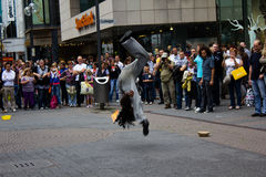 Cologne, Germany - August 13, 2011: Fire show on the street in C. Street artists performing a fire show in Cologne, Germany Royalty Free Stock Images