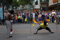 Cologne, Germany - August 13, 2011: Fire show on the street in C. Street artists performing a fire show in Cologne, Germany Stock Images
