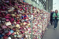 COLOGNE, GERMANY - AUGUST 8, 2015: Love locks at the Hohenzollern Bridge, Cologne, Germany royalty free stock images