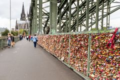 COLOGNE, GERMANY - AUGUST 26, 2014, Thousands of love locks which sweethearts lock to the Hohenzollern Bridge to symbolize their l Stock Photo