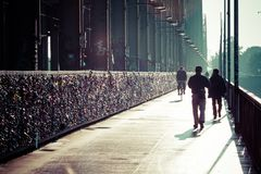COLOGNE, GERMANY - AUGUST 26, 2014, Thousands of love locks which sweethearts lock to the Hohenzollern Bridge to symbolize their l Royalty Free Stock Images