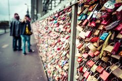 COLOGNE, GERMANY - AUGUST 26, 2014, Thousands of love locks which sweethearts lock to the Hohenzollern Bridge to symbolize their l Stock Photos