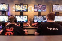 Trade fair visitors playing the game starcraft at Gamescom 2017 Royalty Free Stock Photos