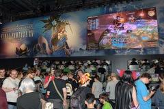 Trade fair visitors waiting and playing the game final fantasy Royalty Free Stock Photos