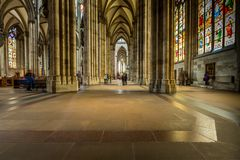 COLOGNE, GERMANY - AUGUST 26: walk way inside the Cologne Cathedral on August 26, 2014 in Cologne, Germany. commenced in 1248 and royalty free stock image
